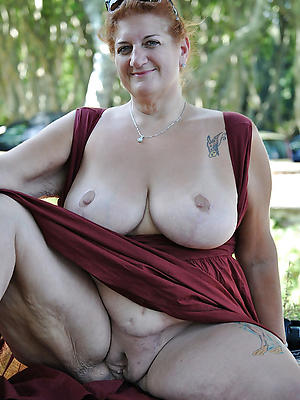 mature tattoos stripped nude