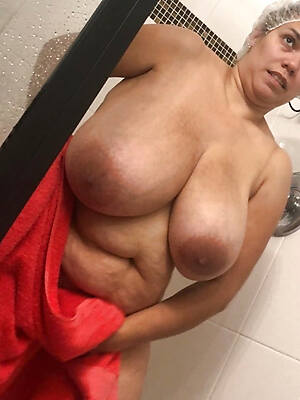 mature in the shower posing naked