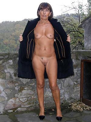 epigrammatic tit mature column posing nude