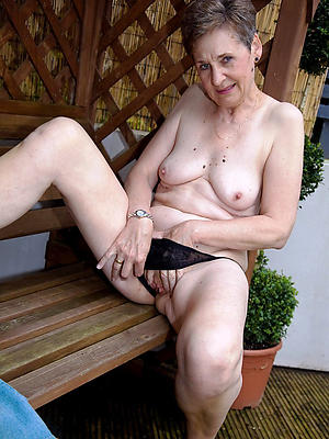 mature milf masturbating posing unadorned