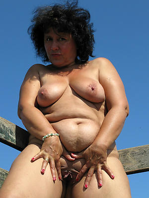 mature wife outdoors stripped