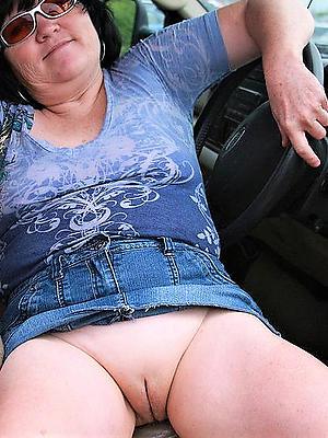 mature in glasses posing nude