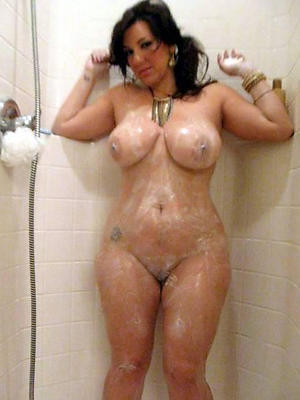 grown-up women showering posing nude