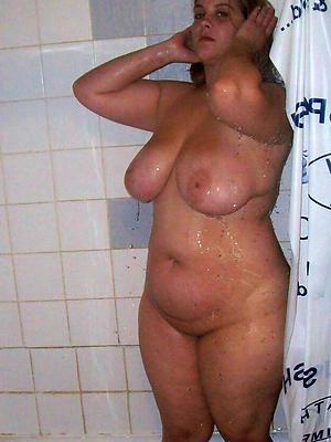 mature stripped shower posing