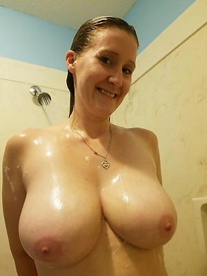estimable grown-up women take the shower
