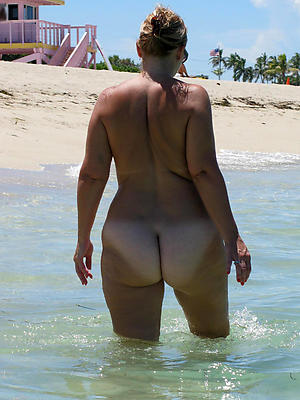 naked mature beach posing