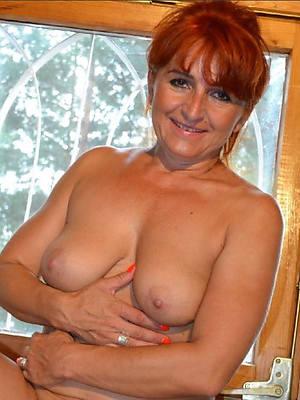 redhead column posing nude