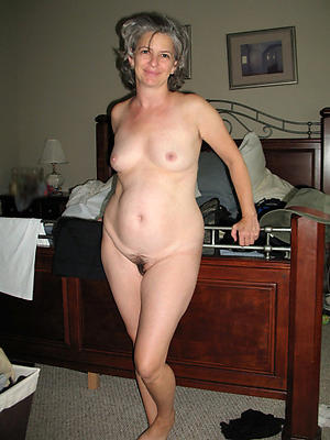 mature small jugs posing nude