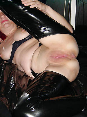 simmering matures in latex displaying her pussy