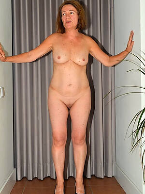 mature older women nude displaying her pussy